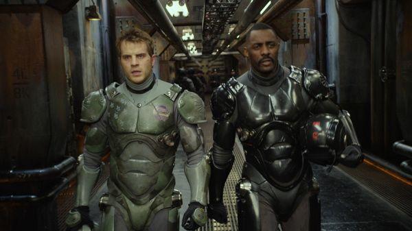 "Rob Kazinsky as Chuck Hansen, left, and Idris Elba as Stacker Pentecost in ""Pacific Rim."""