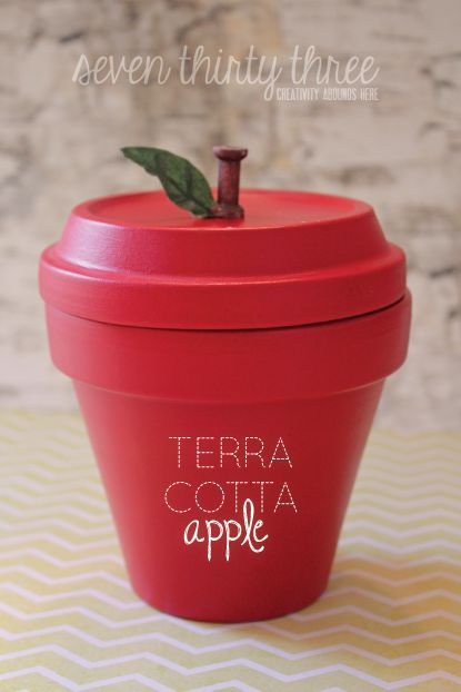 Apple for teacher! Fill it with Smarties – aha!! You'll need: 4″ terracotta pot and saucer Red and brown acrylic paint Wood spool or brown clay Fake leaf Adhesive Paint Brush Clear acry…
