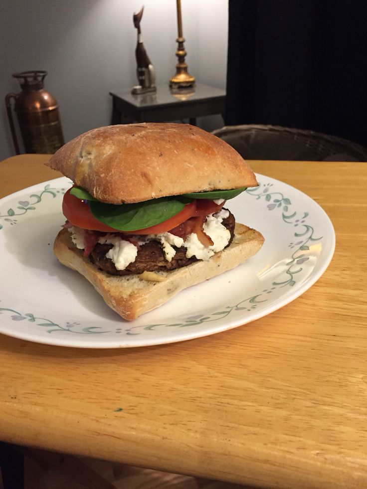 Gourmet goat cheese burger on a poppy seed and onion ciabatta.