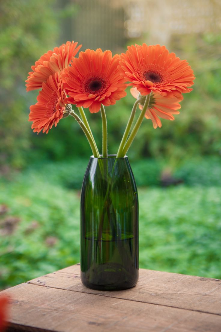UPCYCLED CHAMPAGNE BOTTLE VASE - These stylish and sturdy vases are made from deep green Champagne bottles.  Available to buy now @ www.TwiceDrunk.com.
