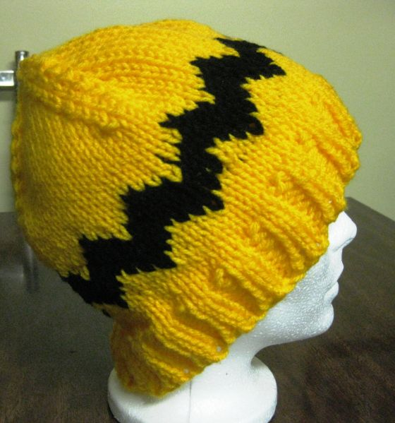 Charlie Brown Beanie You will need: 5mm circular needle 26 inches long 5mm dpn Worsted weight Yellow yarn (main colour) and Black yarn (secondary colour). Gauge: 17st x 23r = 4in(10cm) Cast on 84 s…