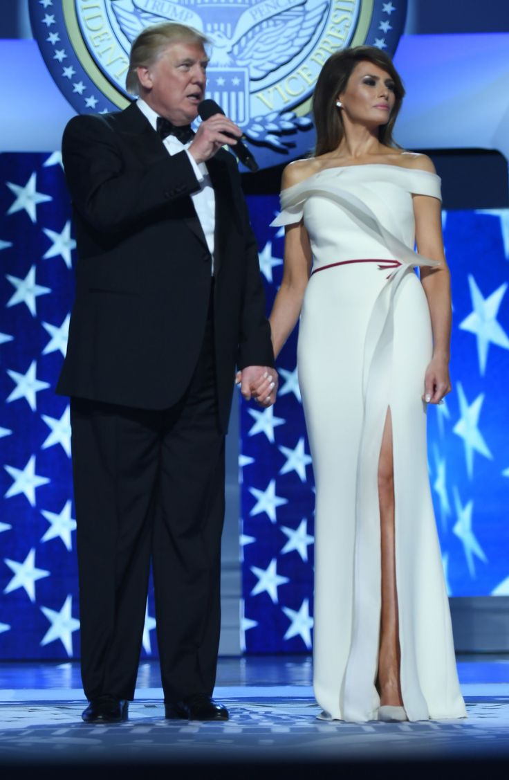 US President Donald Trump speaks as first lady Melania Trump looks on during the Freedom Ball at the Washington DC Convention Center following Donald Trump's inauguration as the 45th President of the United States, in Washington, DC, on January 20, 2017. (Photo by JIM WATSON/AFP/Getty Images)  via @AOL_Lifestyle Read more: https://www.aol.com/article/lifestyle/2017/01/20/melania-trump-wows-in-white-2017-inaugural-ball/21659651/?a_dgi=aolshare_pinterest#fullscreen
