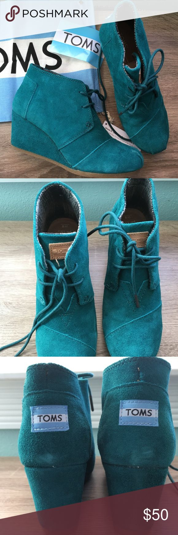 "Toms Desert Wedge In Lake Green Lace up wedge bootie. Suede upper. Teal color. Rubber bottom. Heel is approximately 2 3/4"". Worn a few times and in great condition. Slight almost faded spots. Ships in box. TOMS Shoes Wedges"