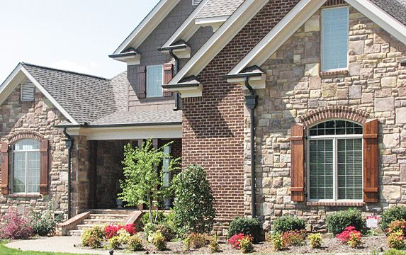 Brick and stone veneer exterior home photos combine for Stone and brick home designs