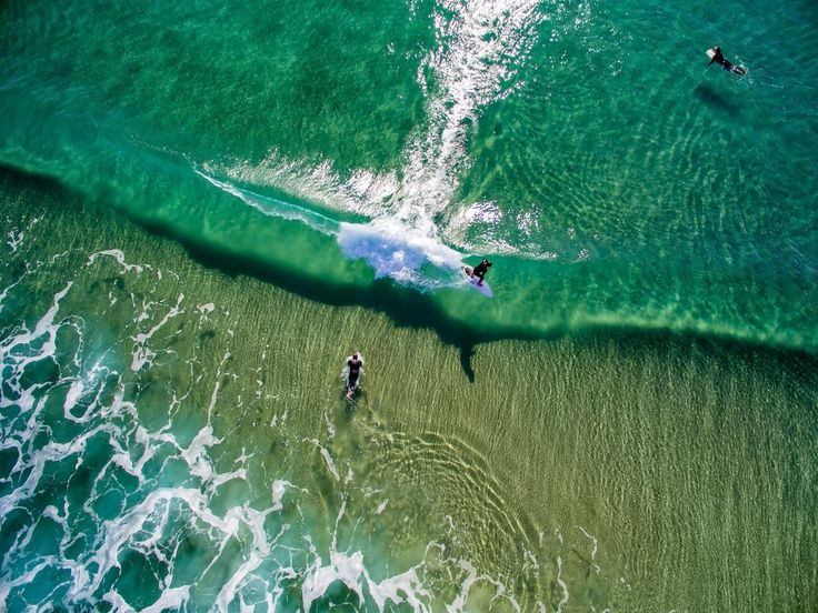 Surfers beyond the break in San Clemente, California.