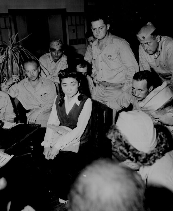 """Correspondents interview `Tokyo Rose.' Iva Toguri, American-born Japanese."" September 1945."