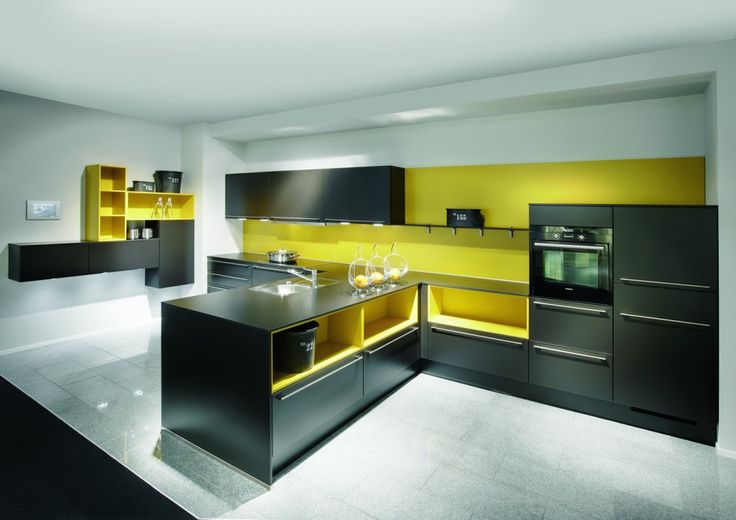 By combining contrasting tones of yellow and black and an elegantly crafted t-shape cabinet layout, this particular design created a sleek, bold and beautifully integrated solution.