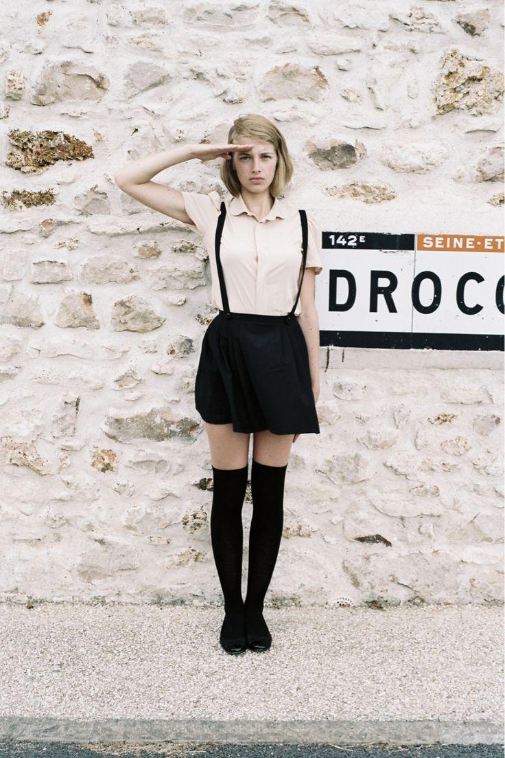 Suspender skirt and knee highs. All black with studded collar or shoulder