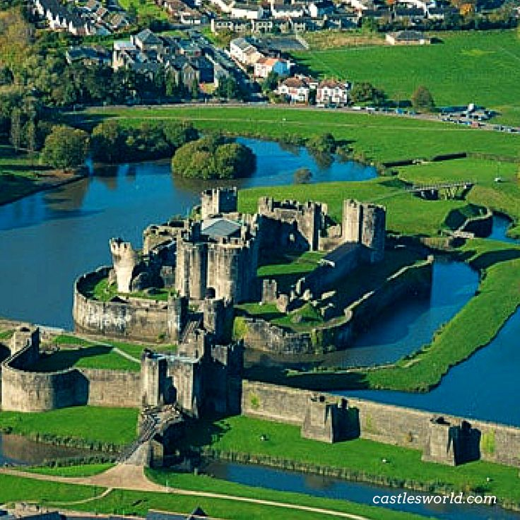 "Caerphilly Castle, Wales The second largest castle in Britain, it is famous for having introduced the formidable concentric castle defenses to the Island. It is considered by historian Allen Brown to be ""the most elaborate water defenses in all Britain"""