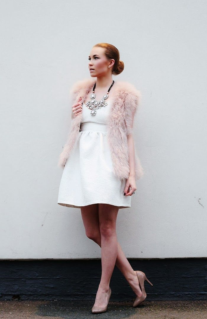 New Year's pastels. Feather vest, white dress, statement jewelled necklace with nude pointytoe pumps. pret-a-porter-sini.blogspot.fi/