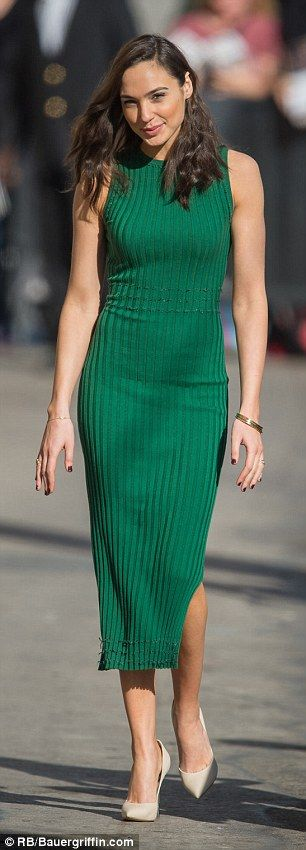 This green dress uses decorative, thin, vertical lines that follow along the whole dress. There is also use of horizontal lines across the waist and bottom of the dress