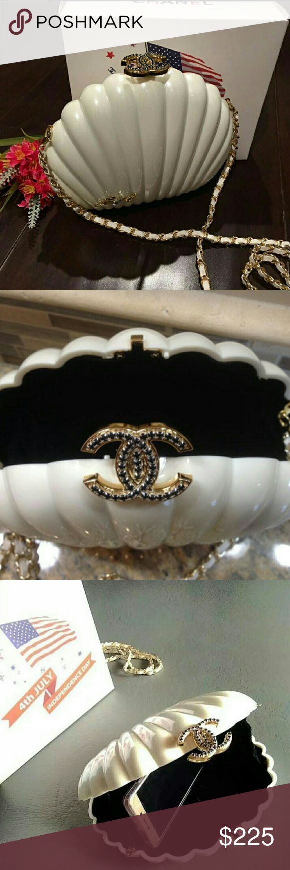 """Chanel VIP Clam Shell 4th of July PRICE FIRM  ChanelVIPLIMITED COLLECTION RARE INDEPENDENCE DAY VIP GIFTWhiteClam ShellCrystal Minaudiere Evening Bag  Black velvet interior with elastic sides Original box. Dimensions 7.5"""" width x 6.5"""" height x 2.5"""" depth 21"""" strap drop  ****************Brand New & 100% Authentic********************  *Not available for sale in boutiques. This is a VIP gift item from Chanel Beaty and does NOT include with hologram sticker, serial number or dust bag…"""