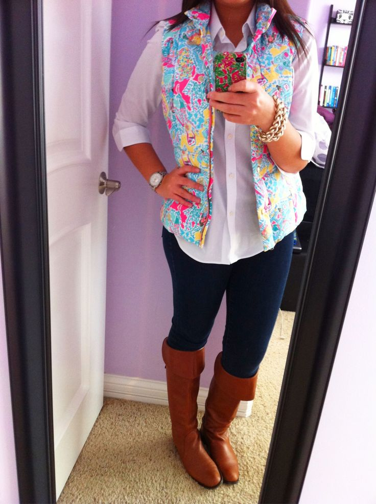 White button down, Lilly Pulitzer vest, skinny jeans, and brown boots.