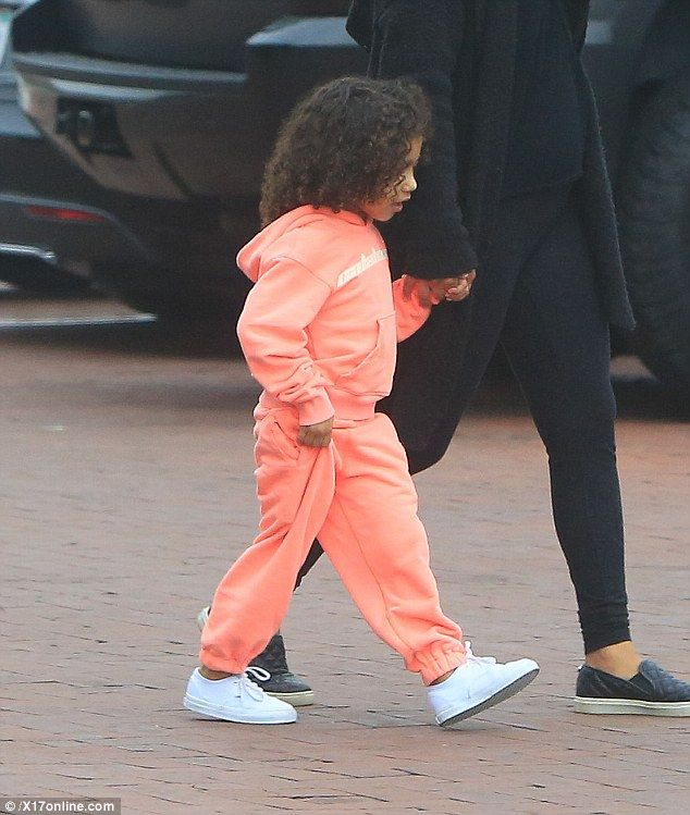 Street style: The youngster was dressed in a coral leisure outfit...