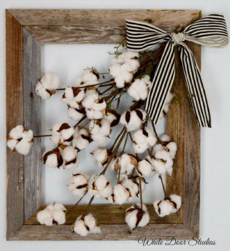 Cotton boll stems inside of a rustic barn wood frame create a charming wall decor piece you are sure to love! Bring some farmhouse style to any room of your home with this unique wall hanging. farmhouse decor, rustic decor, home decor #ad