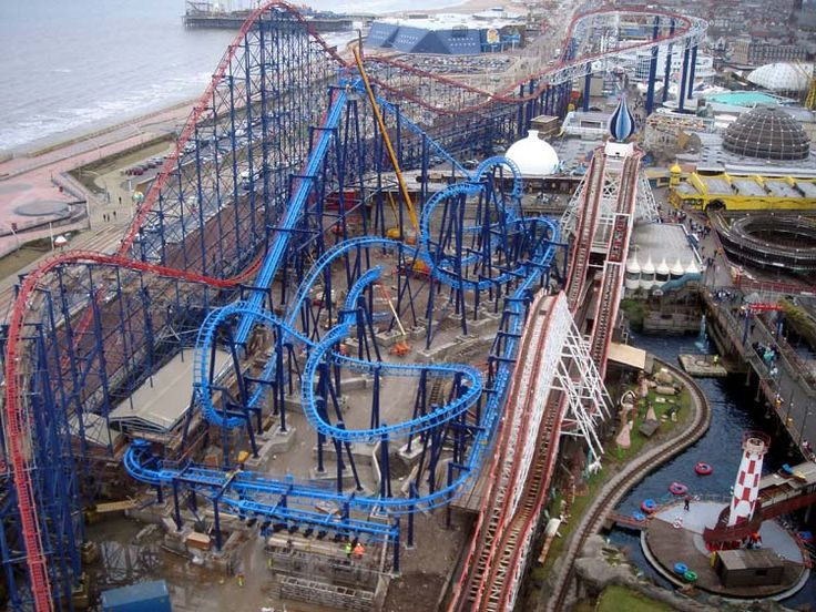 Blackpool Pleasure Beach- constrast of the blue metal constructions against the old wooden white big dipper.