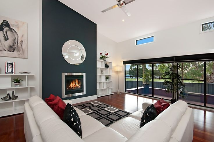 Gas log fire place. Polished floor boards. Raked ceiling. High lite windows.