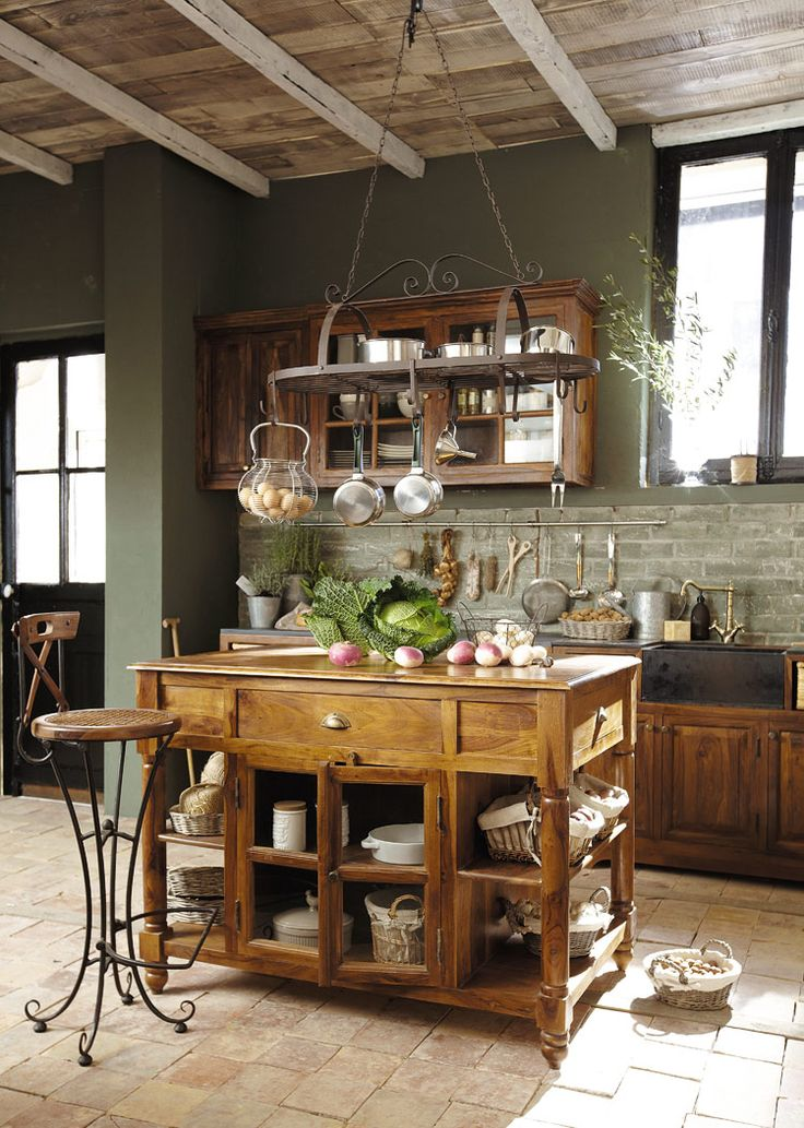 Island, pot rack, farm sink and exposed beams...
