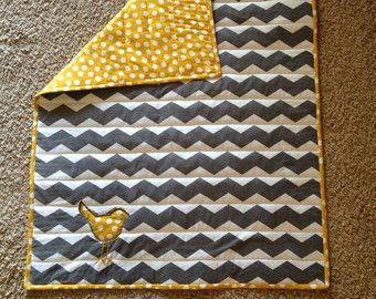 chevron quilt with bird. Just an image...looks like the chevron is the design on the fabric & not pieced from triangles.