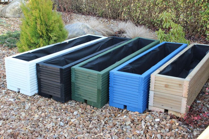 Garden troughs decking boards and trough planters on for Garden decking planters