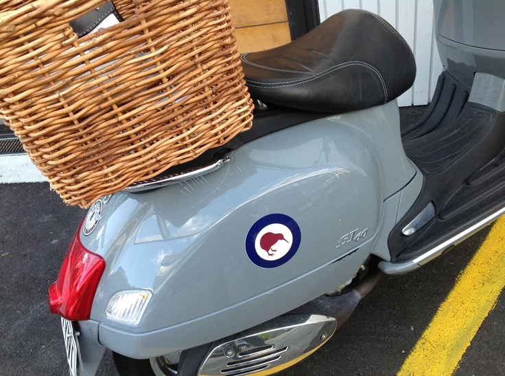 Orange Vespa visits friend at prefab cafe and yes kiwi's can fly
