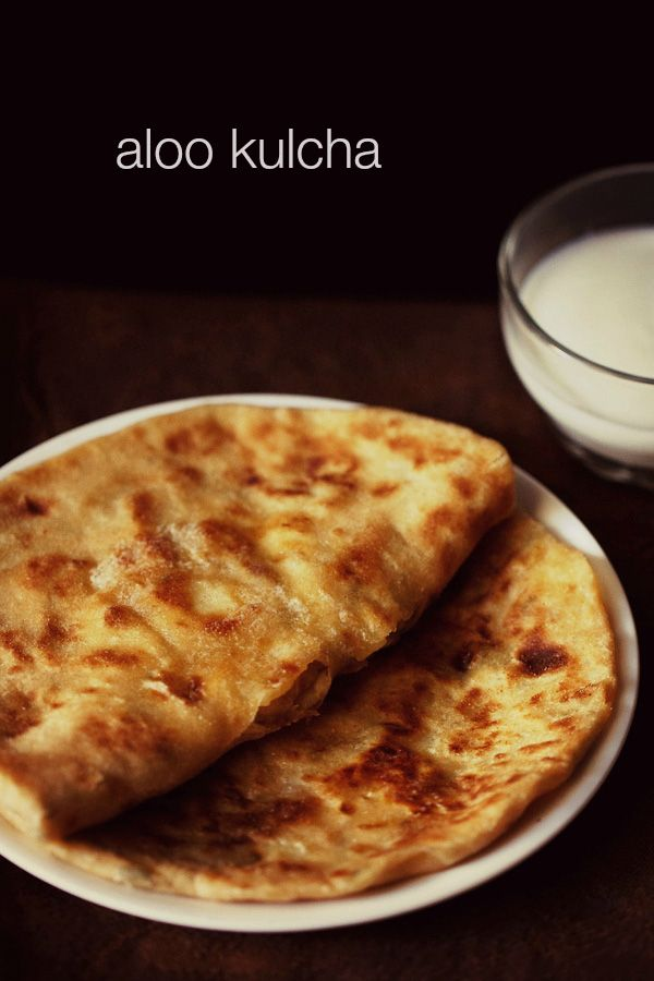 aloo kulcha - crisp and soft leavened flat breads stuffed with a spiced potato stuffing.