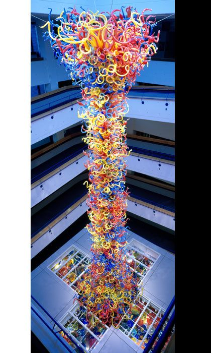 """The Children's Museum of Indianapolis is unveiling a 9-ton glass sculpture by artist Dale Chihuly today.  At 43 feet tall, """"Fireworks of Glass,"""" is the largest permanent blown glass piece that the famed glass artist has ever done.  It is made up of 3,000 individual glass """"horns,"""" as well as a thick glass base that contains another 1,700 pieces."""