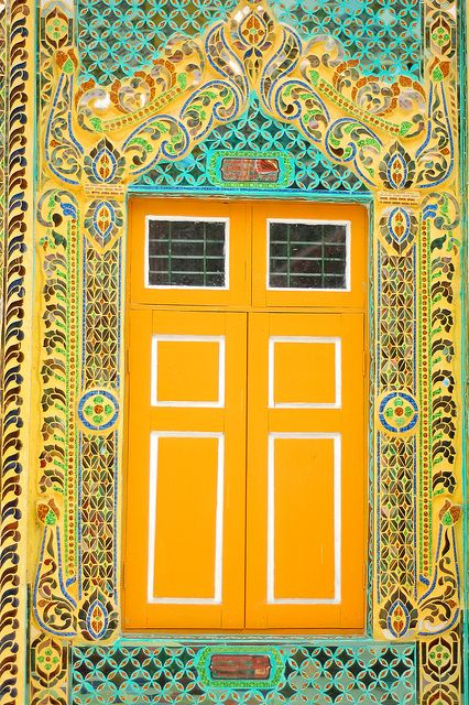 Yellow door at the summit of Mt. Popa in Old Bagan, Myanmar (AKA Burma ). It was decorated with intricate tile designs ~