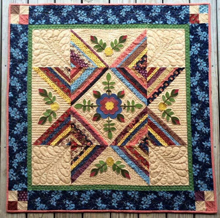 A design by Vicki McCarty posted on Wool and Cotton Applique FB page