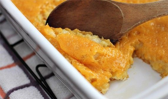 Paula Deen's Corn Casserole  1 (15 1/4-ounce) can whole kernel corn, drained   1 (14 3/4-ounce) can cream corn   1 (8-ounce) box Jiffy corn muffin mix   1 cup sour cream   1/2 cup (1 stick) butter, melted   1 to 1 1/2 cups shredded cheese