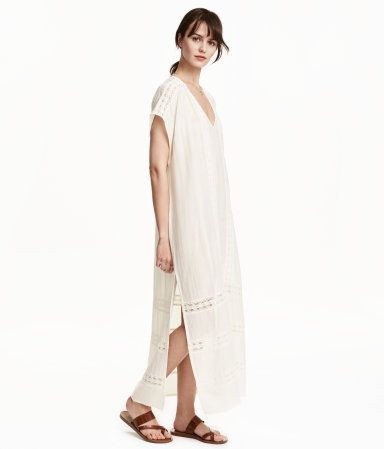 Natural white. Long kaftan dress in airy, woven fabric in a cotton and viscose blend  V-neck. Lace trim inserts, short sleeves with dropped shoulders, and