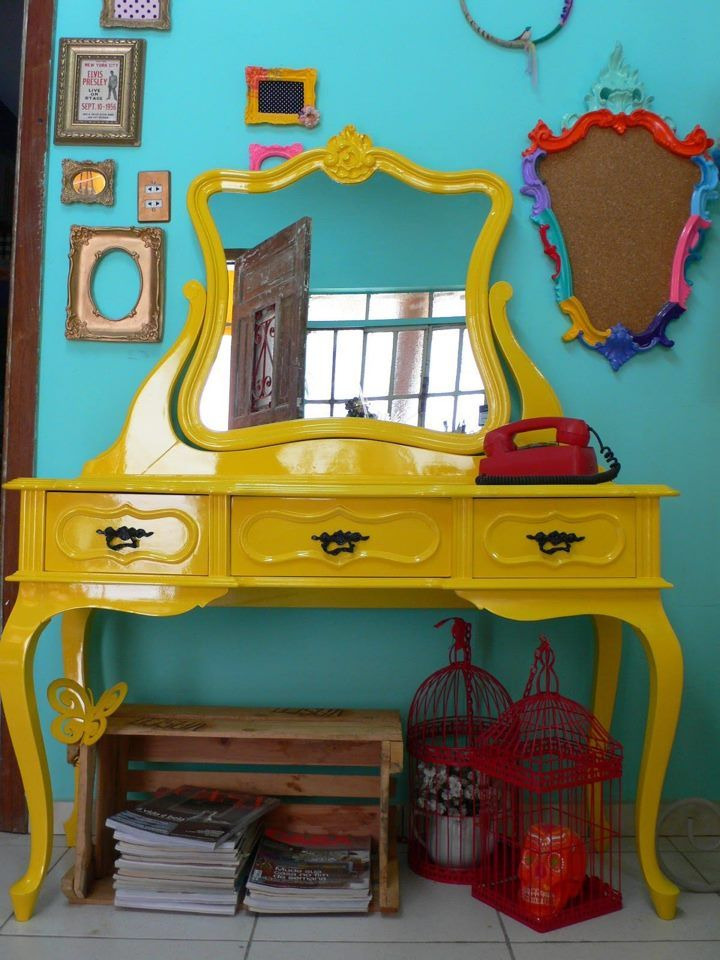 love the yellow dressing table against the turquoise wall