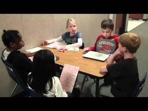 This is a great example of how literature circles are run. The students in this video have written down their own questions on dry erase boards. You can see that the students are asking questions and other students are quick to answer them or the students discuss questions for a good while.