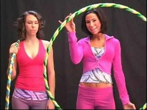Hula Hoop Basics: Vol 1 : How to Start Hula Hooping.  All of her videos on YouTube are so good and go from learning the basics to cool trick moves and stamina. Plus each new move is another video which keeps them all nice and short.