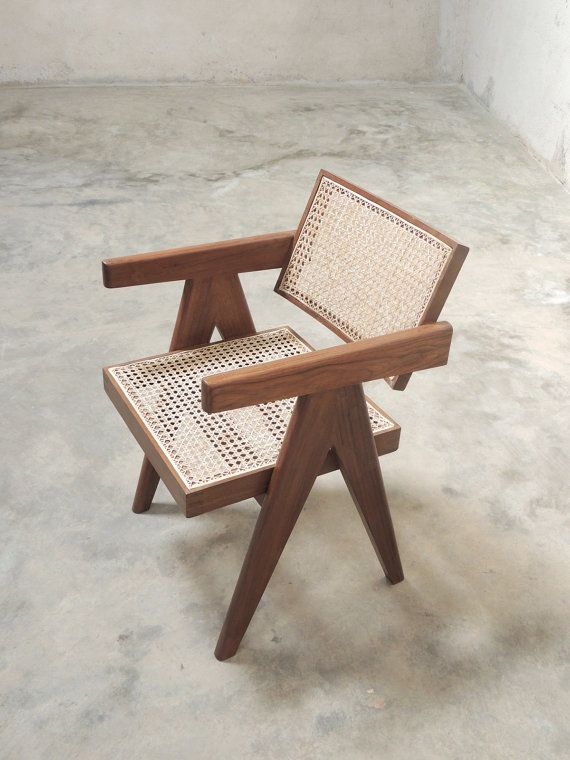 A re-edition of the Office Cane Chair originally made for various administrative offices in Chandigarh. The chair is completely handmade and nuances such as finger joints, inclination of the seat, bowed backrest, gentle rounding of edges along the length of the arms & legs - are given due attention in our edition. Rustic elements of the originals are preserved; for example, the cane is not coloured or polished and cane-work knots at the back of chairs are left exposed. The chair is finish...