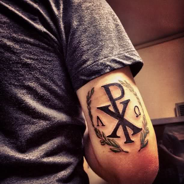 The big XP in the middle are the first two letters of Christ in Greek and the two letters on the left and right are the Greek symbols for Alpha and Omega, the beginning and the end.