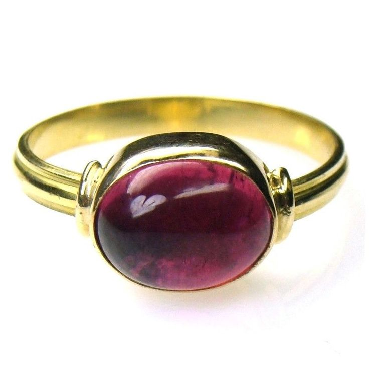 Materials 18k Gold and a Tourmaline. Specifics The ring face is 3/8 inch wide and the ring will be made to your size by the designer. Tourmaline is the birthstone of October.