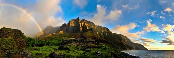 Rugged Nā Pali Coast on Kaua'i provides a rampart against the Pacific—and a pot of tourist gold. Secluded Kalalau Valley is accessible only by boat, when the seas are calm in summer, or by way of a dizzying 11-mile (18-kilometer) trail that hugs the cliffs...