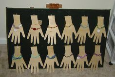 Cutout hands for bracelet display.  Cute idea.  Plain sale cards are $2.99 at Hobby Lobby. Save $3 and have an eye catching card.