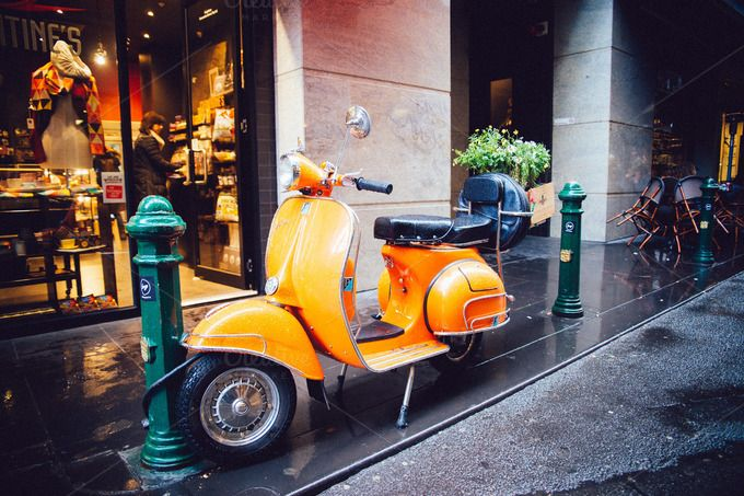 Check out Orange Scooter Bike parks on street by HBStocks on Creative Market