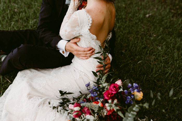 A long sleeve, open-back wedding gown is a subtle nod to sexy | image by Kerlyn Van Gelder