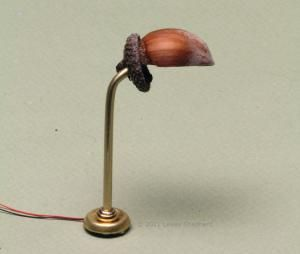 Make a working miniature reading lamp for a table or floor using a small LED bulb as a light source.