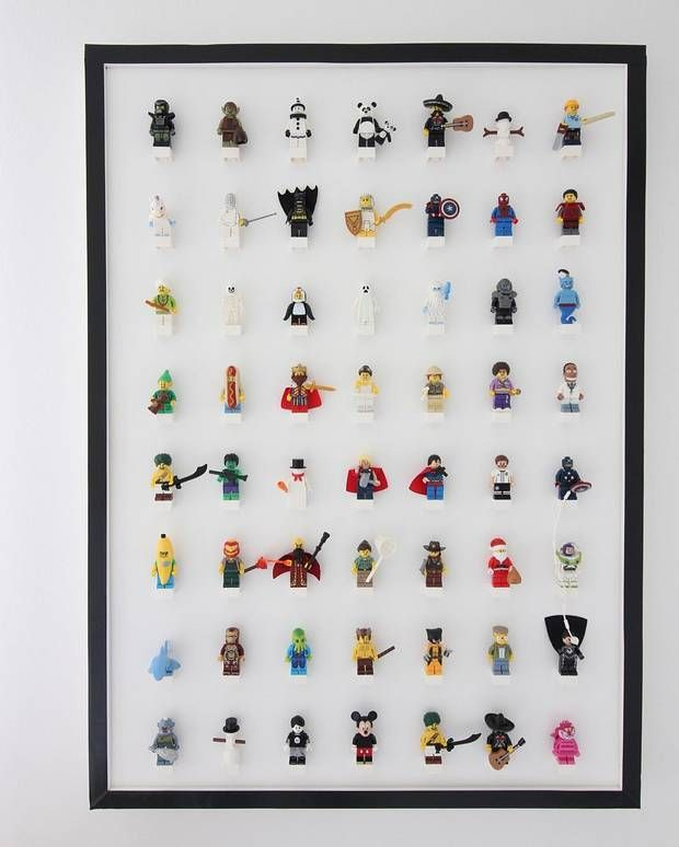 What a great way to display lego figurines! Glue white 4x2 blocks to a white board so the figures can be changed or removed easily. Great for a kid's room (big or small!)