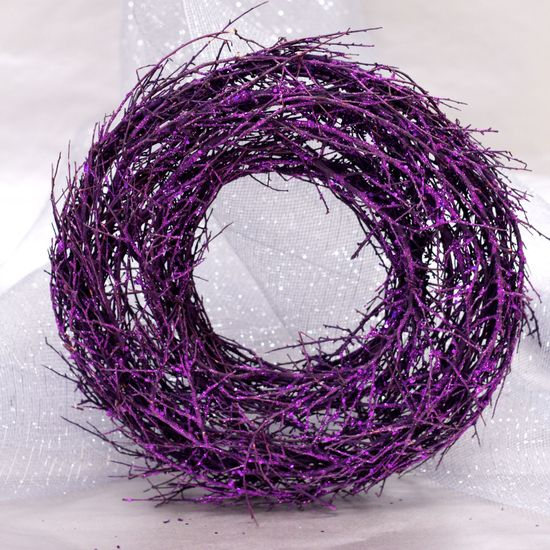 A spin on the traditional twig wreath, add this bright hued and glittery Tula wreath to your front door this season.