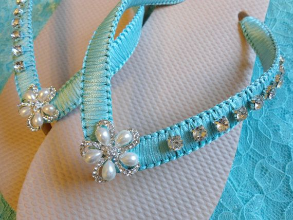 Beige bridal flip flops decorated with Tiffany blue ribbon and rhinestones