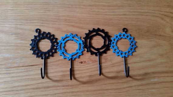 great for any cycling enthusiast, these slick little hooks will hold keys, dish towels, shop tools, etc....made from recycled bicycle gears in my Maryland metal studio! 4 hooks will measure approximately 9 x 6 and are very easy to hang on any wall. these hooks are small and only designed
