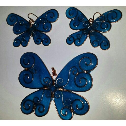 Resin and copper wire butterflies.