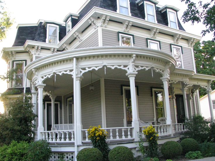 Wrap around porch love it beautiful strange quirky for Homes with porches all the way around