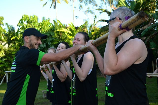 Teamwork..Adam Mulvaney adds some weight to the team bicep curls www.sharingbali.com