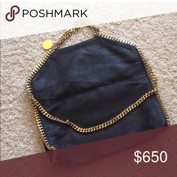 Stella McCartney Falabella Handbag Dark chocolate looks black  chameleon color, when the sun hits you can see the beautiful chocolate color.  Vegan shaggy deer material  Rustic gold hardware  Preloved condition, well taken care of.  💯 Authentic. Please do not ask about the authenticity. Do your research if you're hesitant.  Posh will Authentic the Handbag as well  Open to trade with other designer items. 🌈☘️🌻 Stella McCartney Bags Shoulder Bags